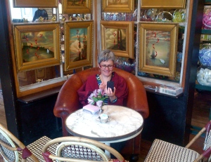 My brother took this photo of me in The Paris Market and Brocante in Savannah ..a delightful spot where we stopped for coffee (and you can tell that I loved this seat!)