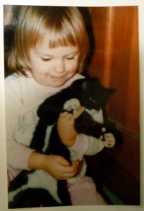 My niece, Mary, when she was a little girl, holding one of her kitties (we are a family of cat lovers!)