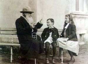 Tolstoy talking with his grandchildren