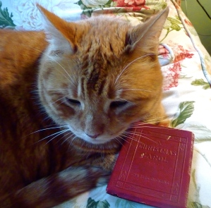 Fred posing with one of my favorite books ( a one hundred year old little leather copy of A Christmas Carol)
