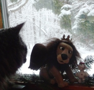 Bodhi checking out 2 of my favorite Christmas decorations (characters from The Land of Misfit Toys).